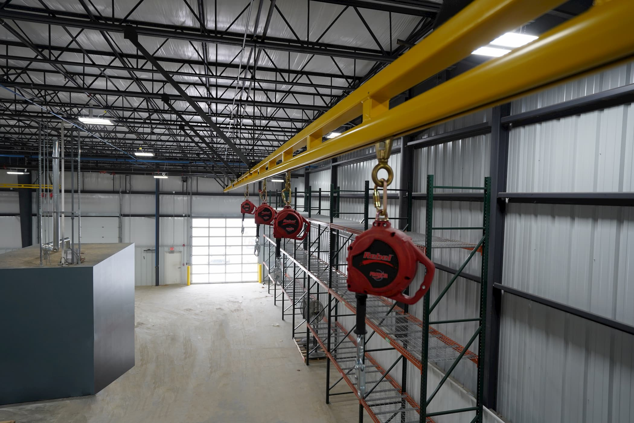 Fall Protection System Using Enclosed Track and SRLs